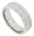 Two raised strips ornamented with Florentine finish decorate this modern men's wedding band
