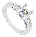 Round diamonds are set in the shoulders of this 14K white gold antique style mounting