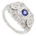Vintage style platinum sapphire and diamond ring has a .39 carat center sapphire with a .04 carat diamond on each side of the sapphire, and thirty six small diamonds set in the mounting for an approximate total diamond weight of .44 carat