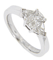Six trillium diamonds are set in this 14K white gold antique style engagement ring