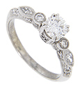 Set with a sparkling .60 carat, H color, Vs2 clarity diamond, this 14K white gold engagement ring incorporates a variety of shapes