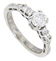 .40 carats total weight of square diamonds set on the shoulders of this 14K white gold engagement ring flank a beautiful .60 carat round diamond