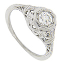 This vintage style platinum filigree diamond engagement ring has a .43 carat diamond, I color, Si clarity and is set in a flower design mounting