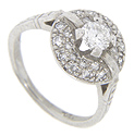 Platinum diamond engagement ring with a .38 carat round center diamond, G color, Vs2 clarity, and .22 carat of diamonds surrounding the center diamond