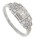 A .22 carat diamond is set in the center of this platinum antique style engagement ring