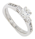 A .60 carat, I color Vs clarity diamond is the focal point of this 14K white gold engagement ring