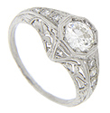 Detailed floral filigree and intricate engraving decorate this antique style platinum engagement ring