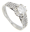 This magnificent 14K white gold estate engagement ring features a double ring design and holds a .65 carat central diamond