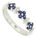 Three clusters of four blue sapphires decorate the top of this 14K white gold antique style wedding band
