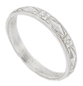 Crafted of 14K white gold, this antique style wedding band is covered with a design that is both geometric and floral