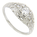 This antique style platinum diamond engagement ring is adorned with diamonds and engraving