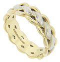 Scalloped yellow gold edges frame a spiraling white gold design on this 14K bi-color gold estate wedding band