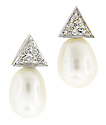 Lustrous pearls are combined triangles of 14K white gold on these antique style earrings