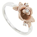 This 14K white gold modern engagement ring features an elegantly crafted 14K red gold rose
