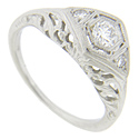 Diamonds adorn the shoulders of this platinum antique style engagement ring