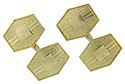 Textured engraving surrounds smoothly polished rectangular plaques on these 14K yellow gold antique cuff links