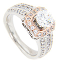 Round diamonds are set in a ring of 14K red gold that surround the center stone on this contemporary engagement ring