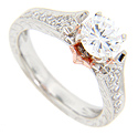 14K red gold accent petals frame the center round stone of the engagement ring in this contemporary wedding set