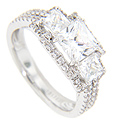 Two smaller square diamonds frame the central square diamond on the engagement ring in this contemporary wedding set