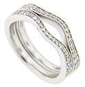 Round diamonds are set in the tops of these 14K white gold antique style curved wedding bands