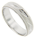 "Gentle ""S"" shapes and milgrain patterning adorn this 14K white gold antique style men's wedding band"