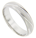 Long, curving lines contrast with the matte finish texture around the circumference of this 14K white gold antique style men's wedding band
