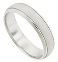 Recessed channels are the sole ornamentation on this matte finish 14K white gold antique style men's wedding band