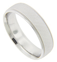 Subtle diagonal patterning covered with a matte finish decorates this 14K white gold antique style men's wedding band