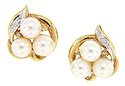 These 14K cultured pearl and diamond estate earrings have omega backs