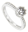 This glittering 14K white gold antique style engagement ring mounting features graduated diamonds running down its shoulders