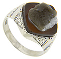 Set in an engraved 10K white gold antique ring, this intricately detailed double cameo is carved out of sardonyx