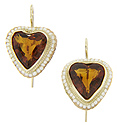 Heart shaped citrines are surrounded by pearls on this 14K yellow gold antique style earrings