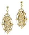 Intricate floral designs ornament these 14K yellow gold antique style earrings