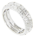 These 14K white gold stackable wedding bands feature a hammered look as well as nine diamonds spaced around each of their circumferences
