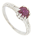 A single round .67 carat Burmese ruby is set in this 14K white gold antique style engagement ring