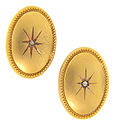 A single diamond is set at the center of these oval art deco 10K yellow gold antique cuff links