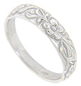 An ornate floral motif done in relief decorates the top half of this 14K white gold antique style wedding band