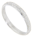 A floral pattern decorates this 14K white gold antique style wedding band