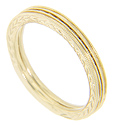 Engraved chevron designs decorate these slim 14K yellow gold antique style stackable wedding bands