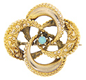 This antique 10K yellow gold love knot pin has an opal in the center