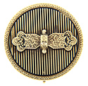 This antique round pin is made of 14K yellow gold