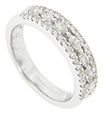 Pairs of pear shaped diamonds ornament the center of this 14K white gold antique style wedding band