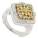A cluster of four round diamonds is surrounded by 18K yellow gold designs on this antique style sterling silver ring