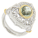 A sparkling faceted oval green amethyst is set in this sterling silver antique style ring