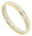 A center band of platinum is flanked by edges of 18K yellow gold on this estate men's wedding band