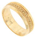 "A repeating ""x"" design is framed by millgrain patterning on this 14K yellow gold estate wedding band"