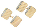 Crafted of 9K yellow gold, these antique cuff links are rectangular in shape