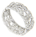 Floral designs set with diamonds span the circumference of this platinum antique style wedding band