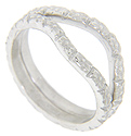 Floral designs decorate these 14K white gold antique style curved wedding bands