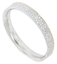 The surface of this 14K white gold antique style wedding band is etched with a repeating floral pattern